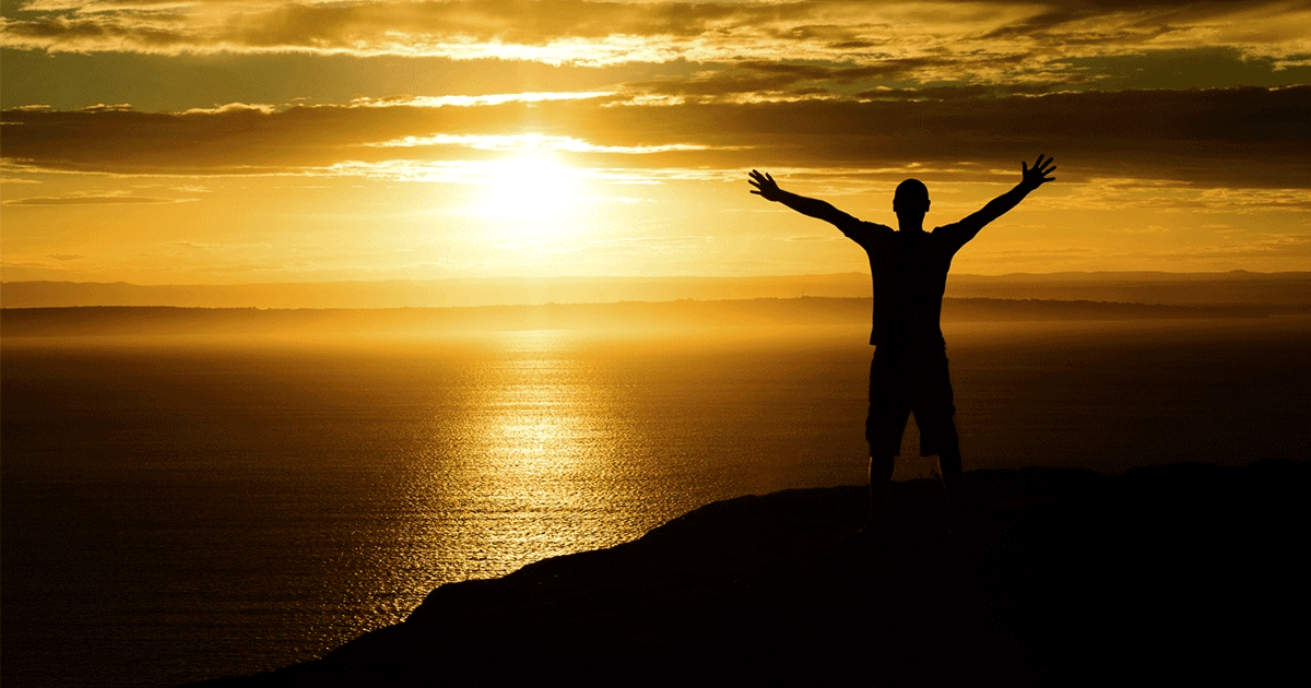14462-sunset-mountain-silhouette-person-arms-raised-social.1200w.tn